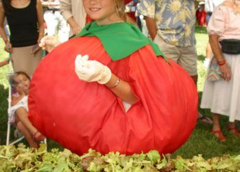 Girl dressed up as a tomato